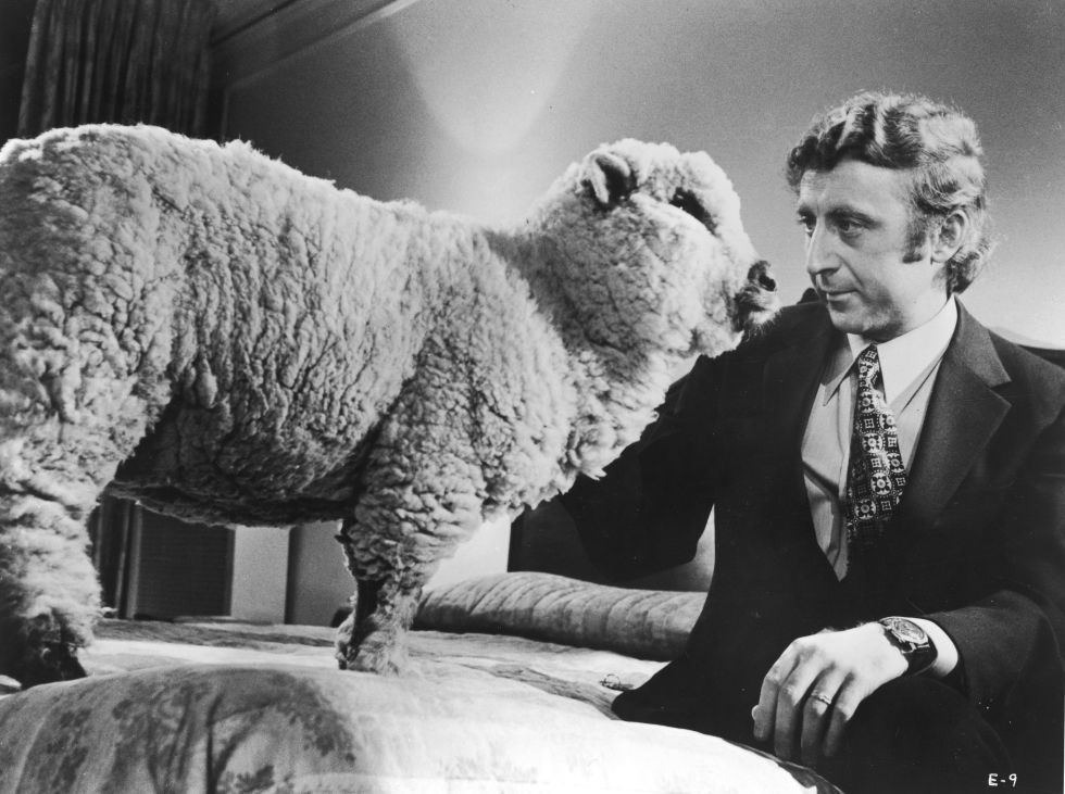 American actor Gene Wilder sits on a bed beside a sheep in a still from the film, 'Everything You Always Wanted To Know About Sex, But Were Afraid To Ask,' directed by Woody Allen, 1972. (Photo by United Artists/Courtesy of Getty Images)