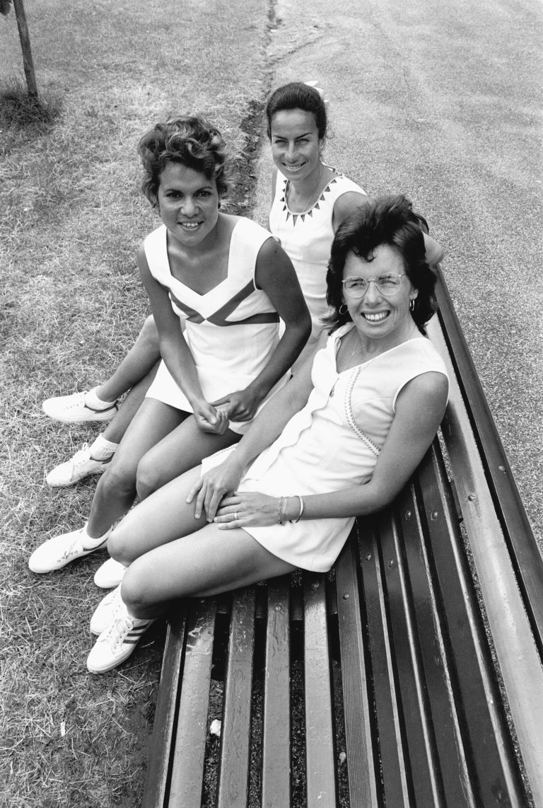 Billie Jean King, Yvonne Goolagong, and Virginia Wade, seated on a bench at the Wimbledon tennis club. (Photo by © Hulton-Deutsch Collection/CORBIS/Corbis via Getty Images)